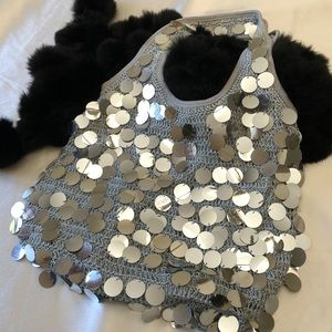 Evening bag, fun silver bangles! It moves with ya!